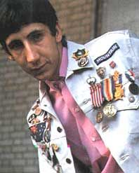 Pete Townshend as a young man wearing jacket with ribbons