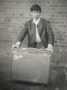 Young Pete Townshend with an amp
